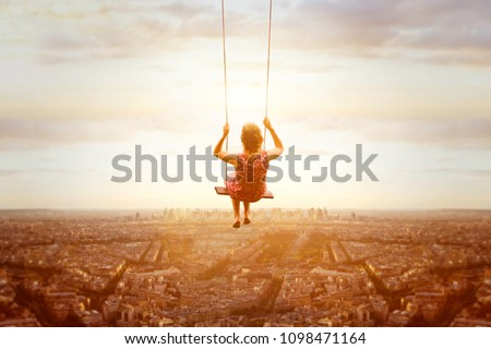 happiness and freedom concept, happy romantic beautiful young girl on the swing above the city landscape, cityscape at sunset, dream, joy and inspiration, inspiring life