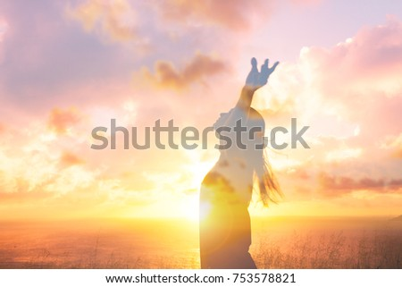 Happiness and freedom. Young at sunset woman with arms in the air. Double exposure.