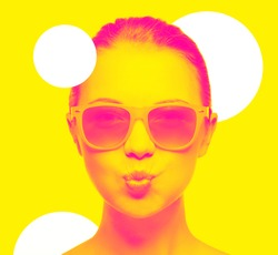 happiness and people concept - portrait of teenage girl in pink sunglasses blowing kiss, trendy duotone effect