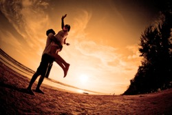 happiness and  romantic Scene of love couples partners on the Beach