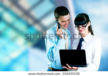 Happiness businessman and businesswoman on blur business architecture background