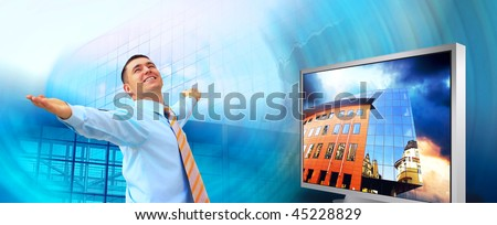 Happiness businessman in the business studio with monitors