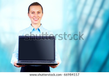 Happiness businesswoman with laptop on blur business architecture background
