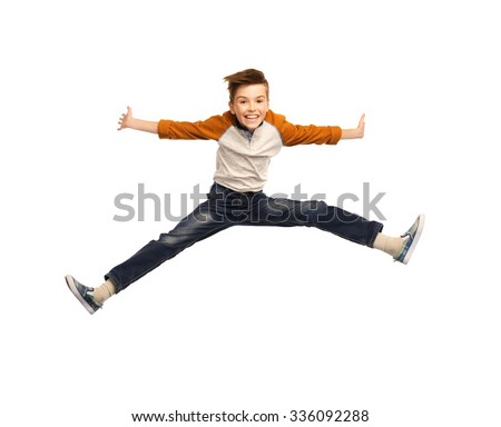 happiness, childhood, freedom, movement and people concept - happy smiling boy jumping in air