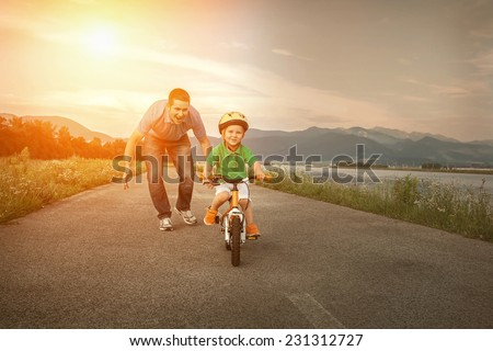 Happiness Father and son on the bicycle outdoor