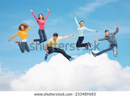 happiness, freedom, friendship, movement and people concept - group of smiling teenagers jumping in air over blue sky with white cloud background