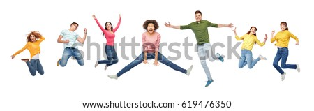 happiness, freedom, motion and people concept - smiling young international friends jumping in air over white background #619476350