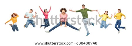 happiness, freedom, motion and people concept - smiling young international friends jumping in air over white background #638488948