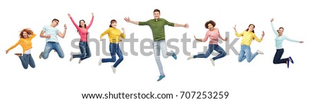 happiness, freedom, motion and people concept - smiling young international friends jumping in air over white background