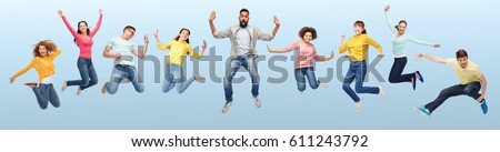 happiness, freedom, motion, diversity and people concept - international group of happy smiling men and women jumping over blue background #611243792