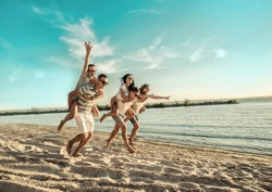 Happiness Friends fun on the beach under sunset sunlight in summer suny day.