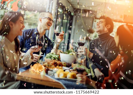 happiness friends thanksgiving christmas eve celebrate dinner party with food wine and laugh together with joyful moment #1175669422