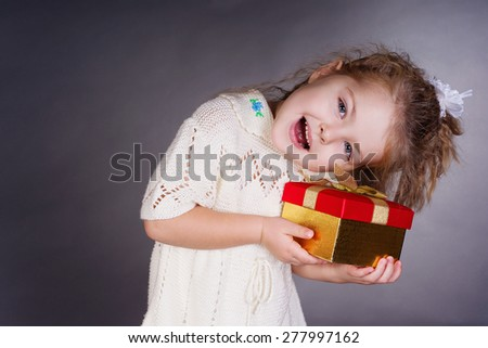 Happiness girl with red gift in her hands, work in studio