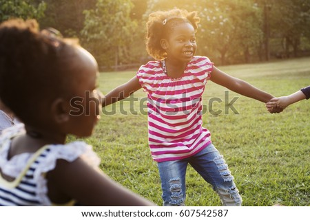 Happiness group of cute and adorable children playing in the park