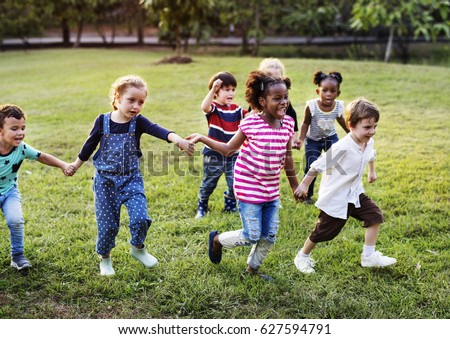 Happiness group of cute and adorable children playing in the park #627594791