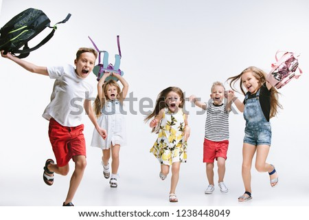 Happiness group of cute and adorable teen children or students are back to school. Sublings day. The friendship, education, childhood, kids fashion concept