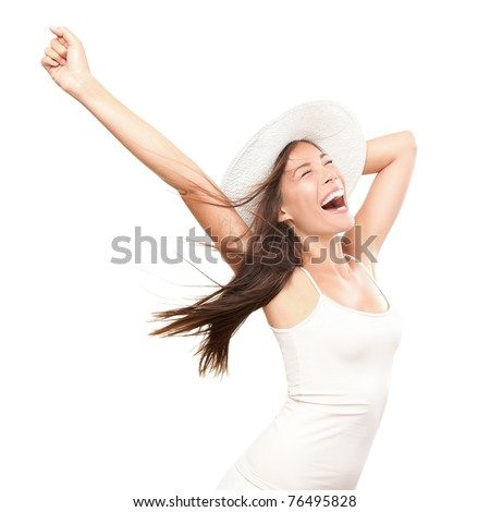 Happiness. Happy summer woman isolated in studio. Energetic fresh portrait of young woman excited cheering in wearing beach hat. Beautiful mixed race Asian Caucasian model isolated on white background
