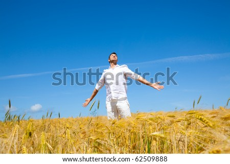 Happiness in golden summer corn field
