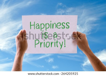 Photo of Happiness is a Priority card with sky background