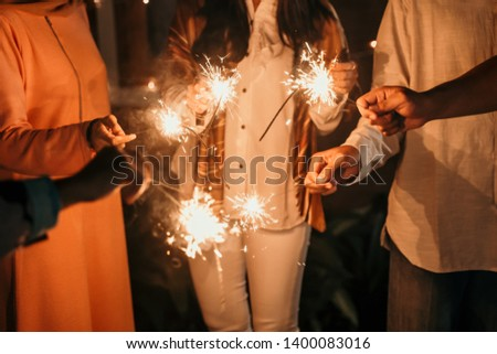 happiness lighting the takbir night fireworks with friends while celebrating the Eid holiday #1400083016