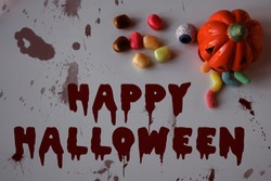 Happu halloween bloody inscription. Pumpkin with worms in mouth. Scarry holidays