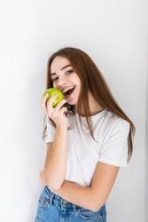 Happu hungry beautiful girl eating apple at home