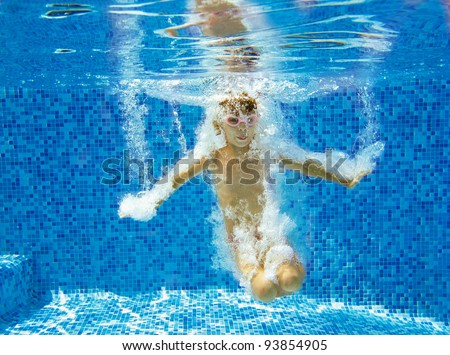 Happy active child jumps to swimming pool, underwater view. Kids sport on summer vacation