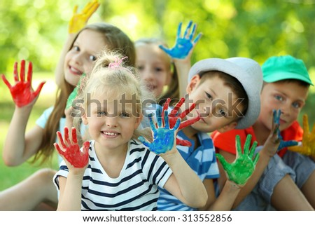 Happy active children with bright colored palms in park #313552856