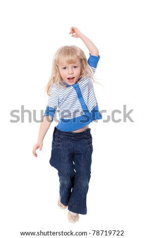 Happy active little girl in move looking at camera