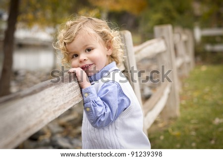 Happy Adorable Young Blonde Boy Playing Outside.