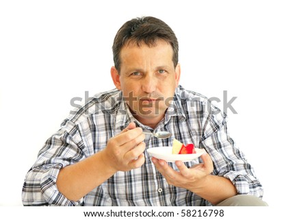 happy adult man with cake over white