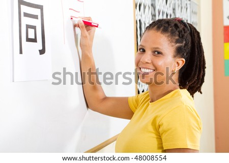 happy adult student learning chinese in classroom