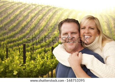Happy Affectionate Couple Hugging at a Beautiful Wine Vineyard.