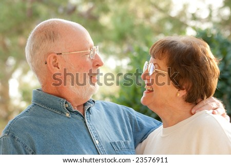 Happy Affectionate Smiling Senior Couple Outdoor Portrait