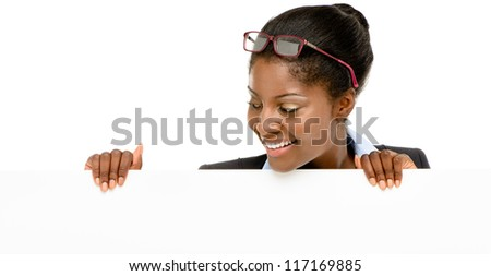 Happy African American business woman hiding behind banner isolated on white background