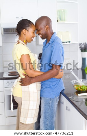happy african american couple in modern kitchen
