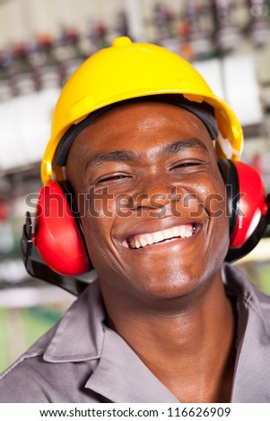 happy african american factory worker closeup portrait