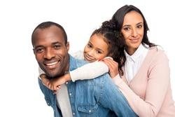 happy african american family hugging and smiling at camera isolated on white