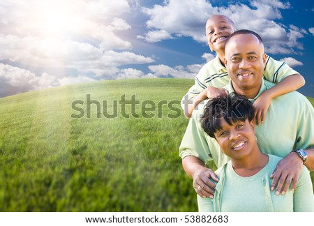 Happy African American Family Over Clouds, Sky and Arched Horizon of Grass Field.