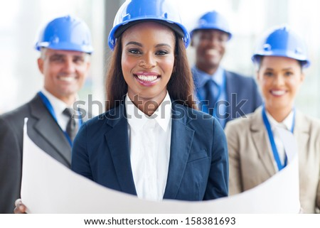 happy african american female architect with team on background
