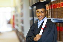 happy african american law school graduate on graduation day