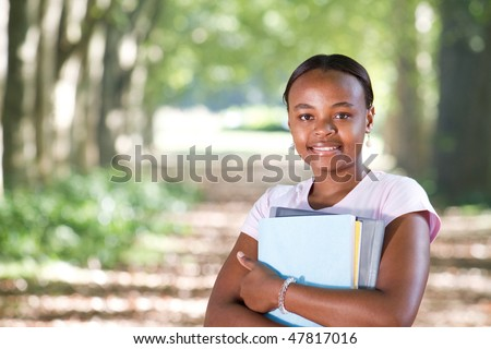 happy african american university student outdoors