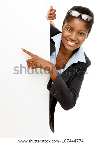 Happy African American Woman pointing at billboard sign white background