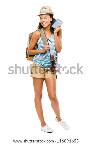 Happy African American woman tourist holding passport