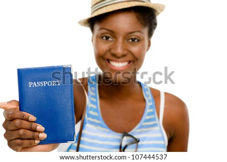 Happy African American Woman tourist holding passport on white background - stock photo