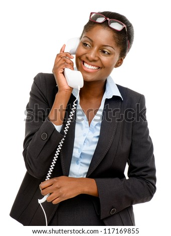 Happy African American woman using analogue phone