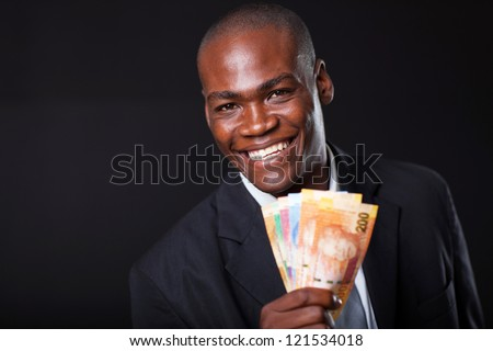 happy african businessman with south african cash notes