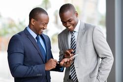 happy african businessmen using smart phone