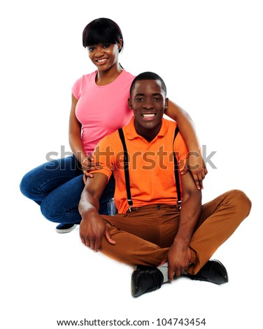 Happy african couple in love isolated over white background