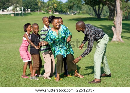 happy african family playing a game together
